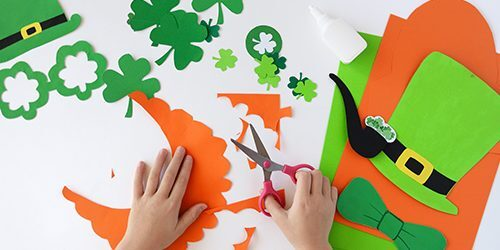 child making St. Patrick's Day crafts